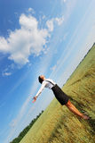 Attractive happy young woman in the field Royalty Free Stock Images