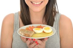 Attractive Happy Young Woman Holding a Healthy Norwegian Style Breakfast Royalty Free Stock Photos