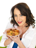 Attractive Happy Young Woman Holding a Plate of Spaghetti Meatballs Royalty Free Stock Photos