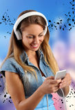 Attractive happy young woman listening to music Stock Image