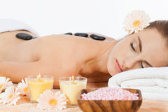 Attractive healthy caucasian woman hot stone massage wellness Royalty Free Stock Photos
