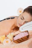 Attractive healthy caucasian woman hot stone massage wellness Royalty Free Stock Photography