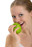 Attractive healthy girl biting an apple isolated. On white background royalty free stock image