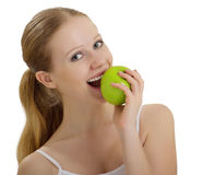 Attractive healthy girl biting an apple isolated. On white background stock photos