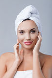 Attractive healthy girl is making facial treatment royalty free stock photo