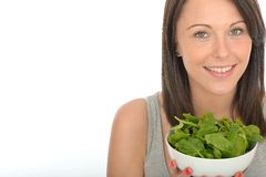 Attractive Healthy Natural Happy Young Woman Holding A Bowl of Raw Spinach Royalty Free Stock Photography