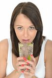 Attractive Healthy Natural Young Woman Holding a Glass of Iced Water with Sliced Lime Royalty Free Stock Image