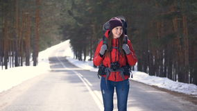 Attractive healthy teen standing on a empty road ready for journey. Slow motion. HD stock video