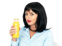 Attractive Healthy Young Woman with Dark Hair Holding a Bottle Orange Juice Royalty Free Stock Image