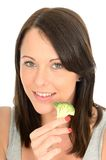 Attractive Healthy Young Woman Eating Broccoli Royalty Free Stock Photo