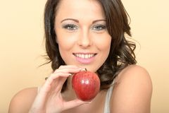 Attractive Healthy Young Woman Holding a Juicy Ripe Shiny Apple Stock Image