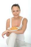 Attractive Healthy Young Woman Holding a Plate of Spaghetti Royalty Free Stock Images