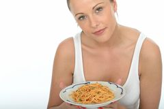 Attractive Healthy Young Woman Holding a Plate of Spaghetti Royalty Free Stock Photos
