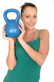 Attractive Healthy Young Woman Lifting a 5kg Kettle Bell Weight Stock Image