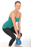 Attractive Healthy Young Woman Lifting a 5kg Kettle Bell Weight Royalty Free Stock Photography