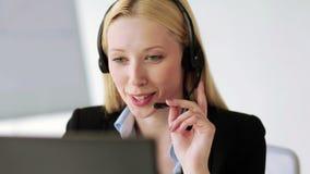 Attractive helpline operator in office stock video