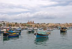 Malta, Marsaxlokk: Attractive, high-colored fishermen boats. Attractive high-colored fishermen boats in the port of the village Marsaxlokk, Malta. They are Stock Photo