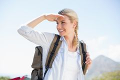 Attractive hiking blonde looking around Stock Image