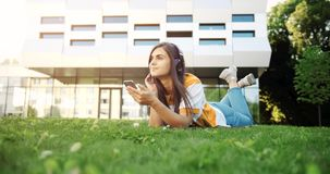 Hipster Woman Listening to Music in Headphones stock video
