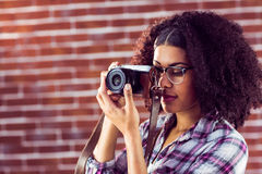 Attractive hipster photographing with camera Stock Photos