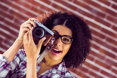 Attractive hipster photographing with camera Stock Image