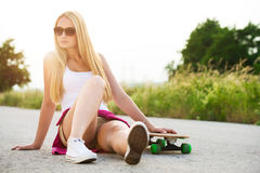 Attractive hipster teenage girl with skateboard Royalty Free Stock Image