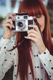 Attractive hipster woman using old fashioned camera Stock Photos