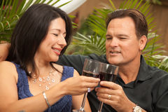 Attractive Hispanic And Caucasian Couple Drinking