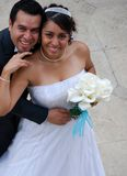 Attractive Hispanic Bride and Groom. Embrace Stock Images