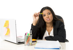 Attractive hispanic businesswoman or secretary suffering breakdown and headache in stress at office. Young attractive hispanic businesswoman or secretary Royalty Free Stock Photos