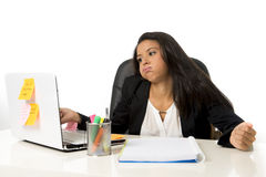 Attractive hispanic businesswoman or secretary suffering breakdown and headache in stress at office Stock Images