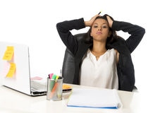 Attractive hispanic businesswoman or secretary suffering breakdown and headache in stress at office Royalty Free Stock Photos