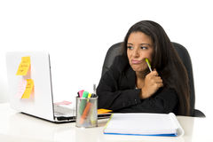 Attractive hispanic businesswoman or secretary suffering breakdown and headache in stress at office Royalty Free Stock Photography