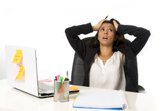Attractive hispanic businesswoman or secretary suffering breakdown and headache in stress at office. Young attractive hispanic businesswoman or secretary Stock Photo