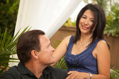 Attractive Hispanic and Caucasian Couple. Happy Attractive Hispanic and Caucasian Couple Portrait Royalty Free Stock Images