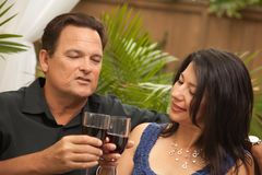 Attractive Hispanic and Caucasian Couple Drinking Stock Photo