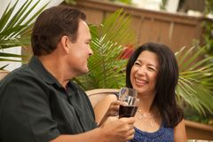 Attractive Hispanic and Caucasian Couple Drinking Stock Photography