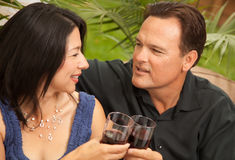 Attractive Hispanic and Caucasian Couple Drinking Royalty Free Stock Photo