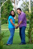 Attractive Hispanic Couple. Standing under an archway and holding hands Royalty Free Stock Photo