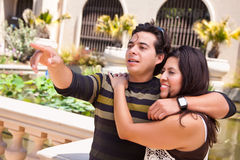 Attractive Hispanic Couple Enjoy the Outdoors. Attractive Hispanic Couple Portrait Enjoying Each Other Outdoors Stock Image