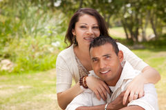 Attractive Hispanic Couple in the Park. Attractive Hispanic Couple Portrait in the Park Royalty Free Stock Images