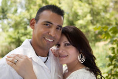 Attractive Hispanic Couple in the Park. Attractive Hispanic Couple Portrait in the Park Royalty Free Stock Photos