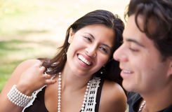 Attractive Hispanic Couple At The Park. Attractive Hispanic Couple Enjoying Themselves At The Park Stock Photos