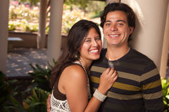 Attractive Hispanic Couple Portrait Outdoors. Attractive Hispanic Couple Portrait Enjoying Each Other Outdoors Stock Photo