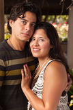 Attractive Hispanic Couple Portrait Outdoors. Attractive Hispanic Couple Portrait Enjoying Each Other Outdoors Stock Images