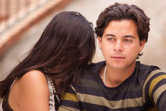 Attractive Hispanic Couple During A Serious Moment. At a Fountain Stock Photo