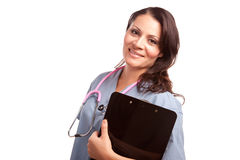 Attractive Hispanic Doctor or Nurse with Clipboard Royalty Free Stock Photography