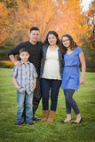 Attractive Hispanic Family Portrait in a Colorful Fall Outdoor S Stock Images