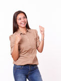 Attractive hispanic female celebrating her victory Stock Photography