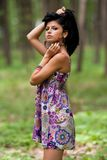 Attractive hispanic girl in the forest Stock Photo